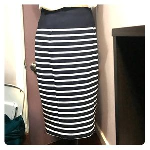 Striped knee length skirt.
